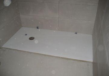 Colocación platos de duchas