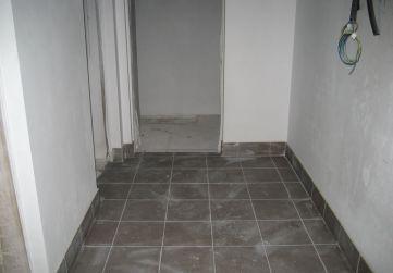 Solados pasillo trasteros
